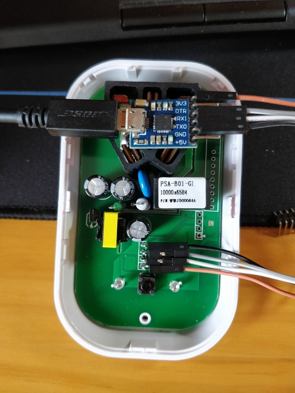 Sonoff socket connected to a UART-USB-Adapter to flash new firmware.
