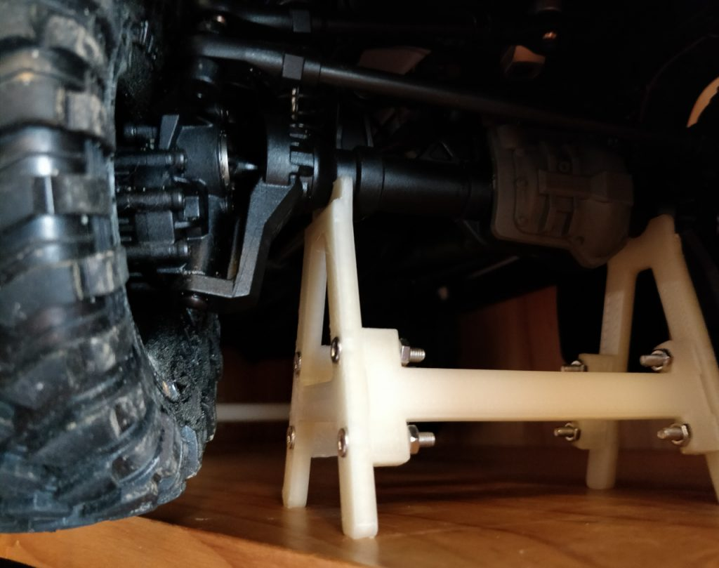 The stand is pushing against the axle, so the springs and dampers are still under load.