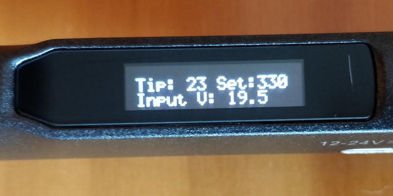 Main screen showing tip temperature, set temperature and voltage.